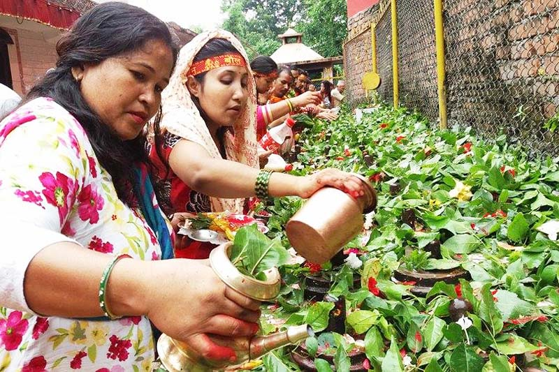 Devotees worship 108 Shiva lingas in Devghat Dham of Chitwan district on the first Monday of the holy month of Shrawan, July 18, 2016. Photo: Tilak Ram Rimal
