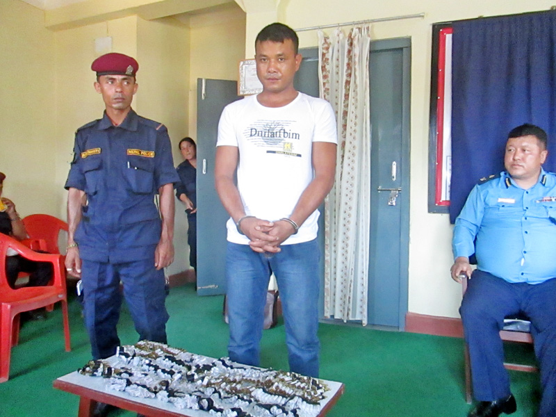 Tanahun District Police Office parades Dhan Bahadur Kumal arrested on charge of drug smuggling, in Damauli, on Wednesday, July 13, 2016. Photo: Madan Wagle