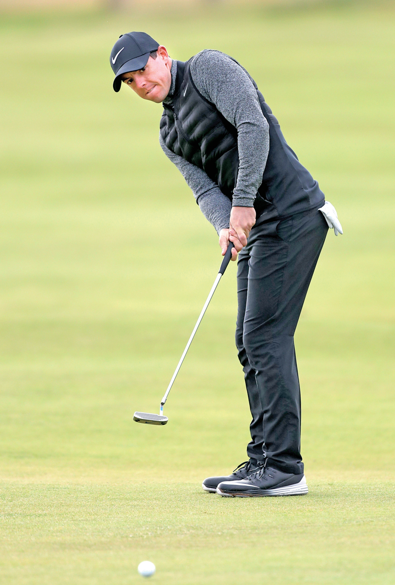Rory McIlroy of Northern Ireland putts on the 16th green during a practice round, on the eve of the 145th British Open Golf Championship, in Troon on Wednesday.