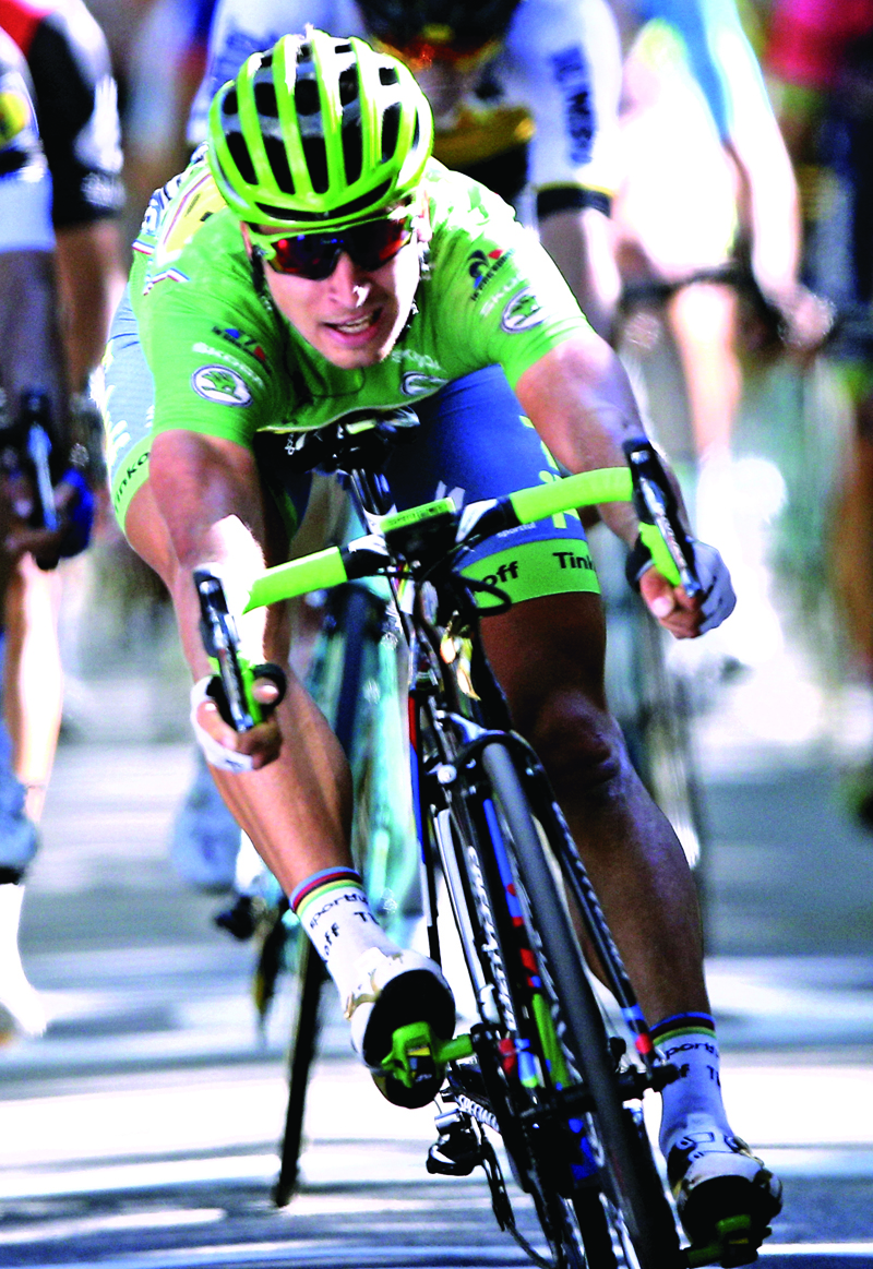 Peter Sagan of Slovakia, wearing the best sprinteru2019s green jersey, crosses the finish line to win the 16th stage of the Tour de France in Bern on Monday.