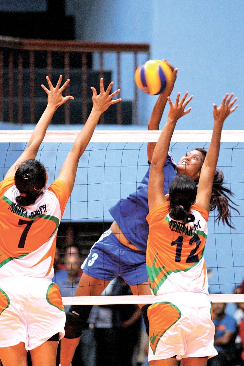 Nepal's Saraswati Chaudhary attempts a spike as India players jump for a block during their friendly match in Kathmandu on Friday, July 29, 2016. Photo: Udipt Singh Chhetry/ THT