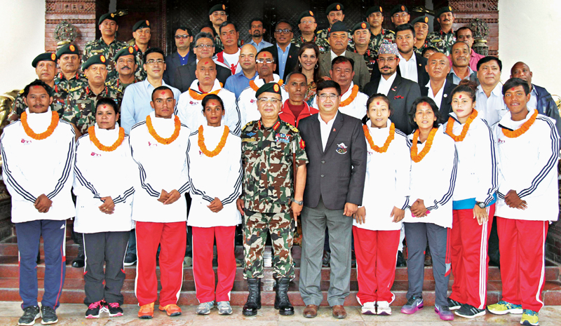 Nepalu2019s Rio Olympic Games squad members pose for a group photo with Chief of the Army Staff Gen Rajendra Chhetri, Nepal Olympic Committee President Jeevan Ram Shrestha and other officials after being honoured by Nepal Army in Kathmandu on Friday.