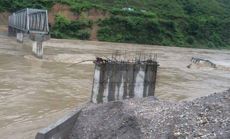 An under-construction truss bridge over the Kali Gandaki River, bordering Nawalparasi and Tanahun districts, is reportedly swept away by a flood, on Saturday, July 2, 2016. Photo: Bir Bahadur BK via THT Online