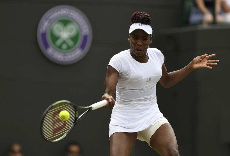 USA's Venus Williams in action against Kazakhstan's Yaroslava Shvedova during Wimbeldon Lawn Tennis in London on Tuesday, July 5, 2016. Photo: Reuters