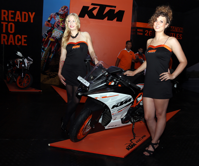 Models pose for a photo along with a newly launched motorbike at the 11th NADA autoshow, at  Bhrikutimandap in Kathmandu, on Tuesday, August 30, 2016. Photo: RSS