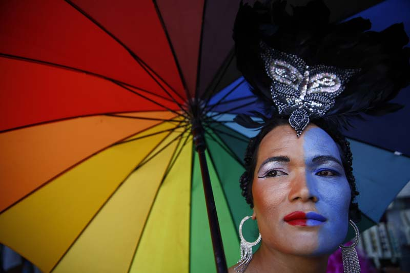 A reveller looks on while taking part in a pride parade of LGBT (lesbian, gay, bisexual and transgender) in Thamel, Kathmandu, on Friday, August 19, 2016. Photo: Skanda Gautam