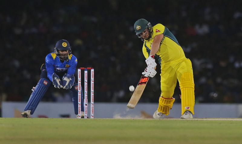 Australia's Aaron Finch plays a shot against Sri Lanka as Kusal Perera watches during their third one day international cricket match in Dambulla, Sri Lanka, Sunday, August 28, 2016. Photo: AP