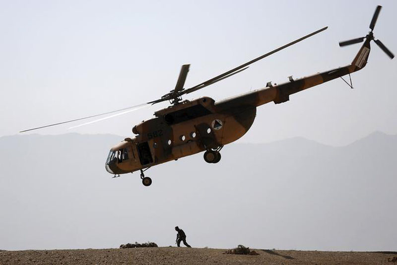 An Afghan National Army (ANA) helicopter flies over a soldier during a training exercise at the Kabul Military Training Centre in Afghanistan, on October 7, 2015. Photo: Reuters