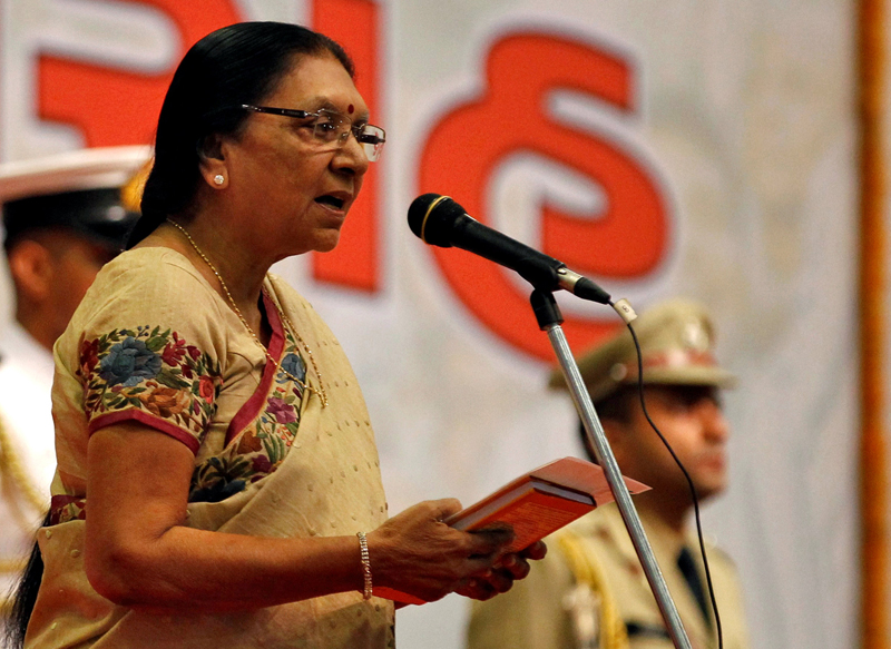 Anandiben Patel, the newly appointed chief minister of the western Indian state of Gujarat, takes her oath during a swearing-in ceremony at Gandhinagar in Gujarat, India, May 22, 2014. Photo: Reuters