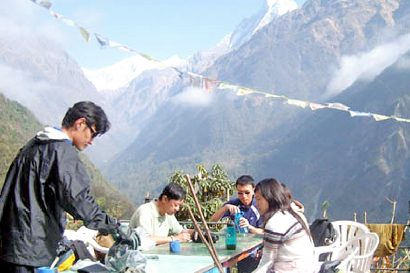 File photo shows tourism entrepreneurs having a meal on the way to Annapurna Base Camp. Photo: THT