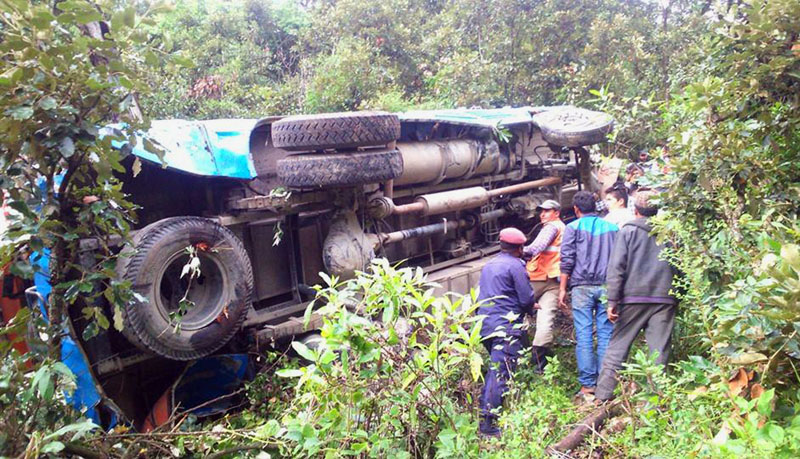 Wreckage of a bus that fell off a cliff near Brindaban in Sidhheshwar-3 of Baitadi district on Monday, August 15, 2016. Four persons died in the incident while 36 are injured. Photo: RSS