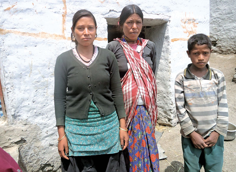 Reuli Sarki, whose husband was killed during the insurgency era by state forces, along with her children in Pandusain VDC, Bajura, on Thursday.