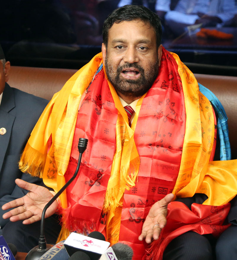 Deputy Prime Minister Bimalendra Nidhi talking to the media at the Tribhuvan International Airport after returning from his visit to India as Prime Minister Pushpa Kamal Dahal's special, on Tuesday, August 23, 2016. Photo: RSS