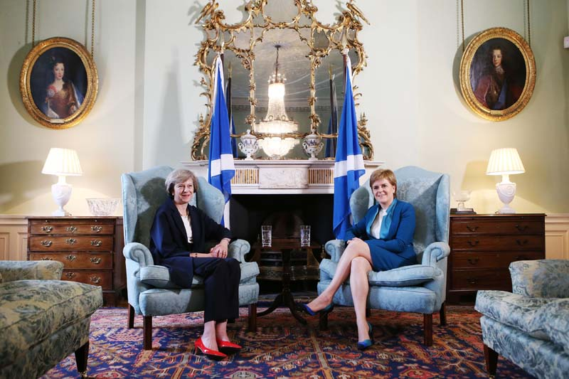 File- Britain's Prime Minister Theresa May (L) meets with Scotland's First Minister Nicola Sturgeon at Bute House in Edinburgh, Scotland, on Friday, July 15, 2016. Photo: AP