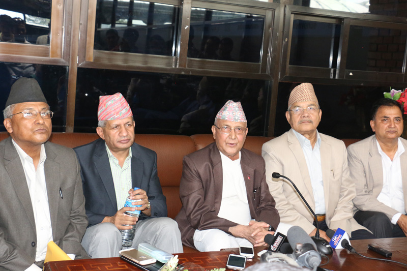 FILE: CPN-UML Chairman and immediate past prime minister KP Sharma Oli (centre) speaks with journalists before leaving for Bangkok on a medical trip, at the Tribhuvan International Airport, on Thursday, August 25, 2016. Photo: RSS