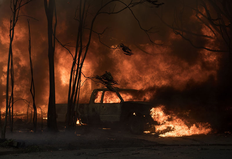 A truck burns in the town of Lower Lake, Calif. on Sunday, Aug. 14, 2016. Flames continue to burn out of control in the area. Photo: AP