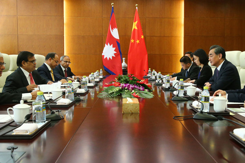 China's Foreign Minister Wang Yi (right) speaks with Nepal Premier's special envoy Krishna Bahadur Mahara, left, during their meeting at the Ministry of Foreign Affairs in Beijing, China, on Tuesday, August 16, 2016. Photo: Wu Hong, Pool Photo via AP