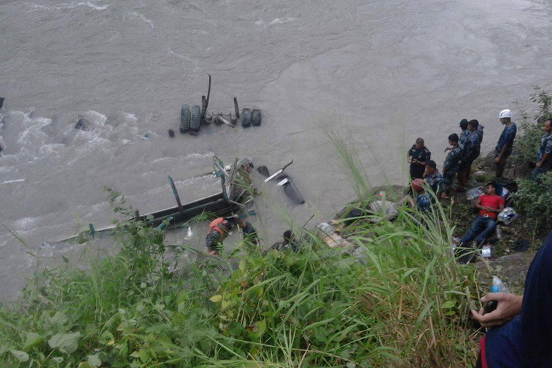 Security personnel deployed from Chitwan District Police Office in search and rescue operation for the passengers of the bus that plunged into Trishuli River near Kalikhola along the Narayangadh Munglin road section on Friday, August 26, 2016. Photo: Tilak Ram Rimal/THT
