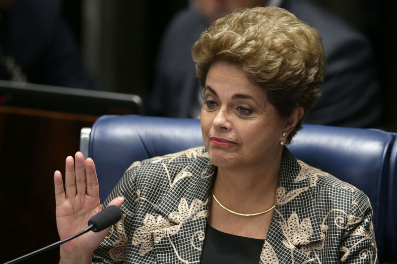Suspended Brazilian President Dilma Rousseff waves goodbye after her impeachment trial at the Federal Senate in Brasilia, Brazil, on Monday, August 29, 2016. Photo: AP Photo
