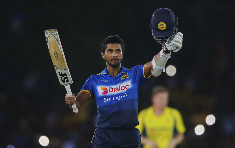 Sri Lanka's Dinesh Chandimal celebrates as he scores a hundred against Australia during their third one day international cricket match in Dambulla, Sri Lanka, Sunday, August 28, 2016. Photo: AP