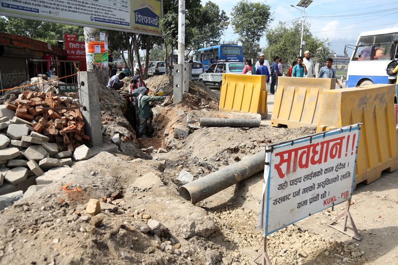 Drinking water pipeline extension work is going on in Ratna Park on Kathmandu, on Saturday, August 27, 2016. Photo: RSS