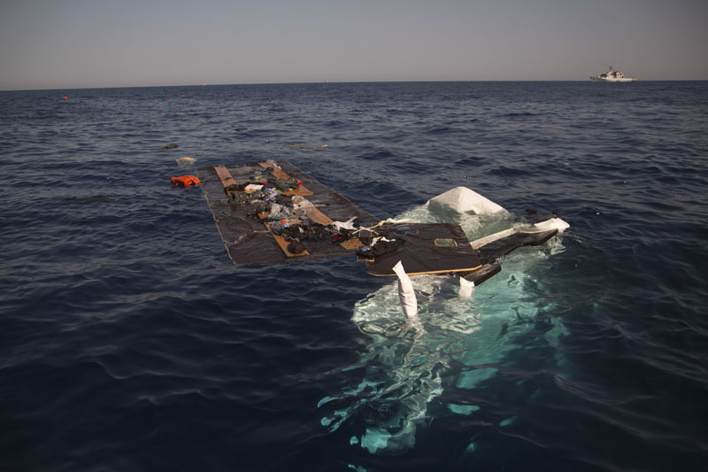 The remains of a dinghy is seen partially sank after a rescue operation by members of Proactiva Open Arms NGO, at the Mediterranean sea, about 17 miles north of Sabratah, Libya, on Saturday, August 20, 2016. Photo: AP