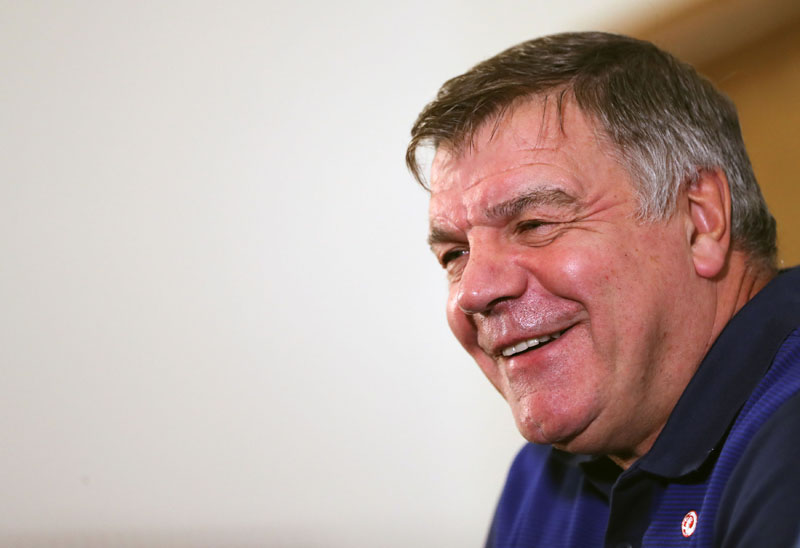 England football team manager Sam Allardyce, smiles during the press conference at St George's Park, Burton central England, on Monday August 29, 2016.  England will play Slovakia in a World Cup qualifying group match in Slovakia on Sunday. Photo: Simon Cooper/PA via AP