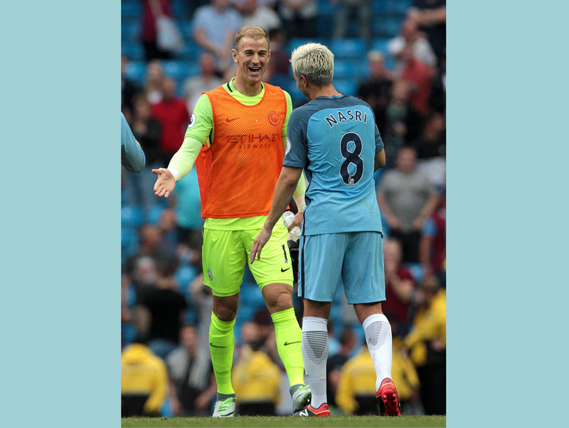 Manchester City goalkeeper Joe Hart (left) celebrates with team-mate Samir Nasri after the final whistle following the Premier League match Manchester City versus West Ham United at the Etihad Stadium, Manchester, England, Sunday Aug. 28, 2016. Photo: Peter Byrne/PA via AP