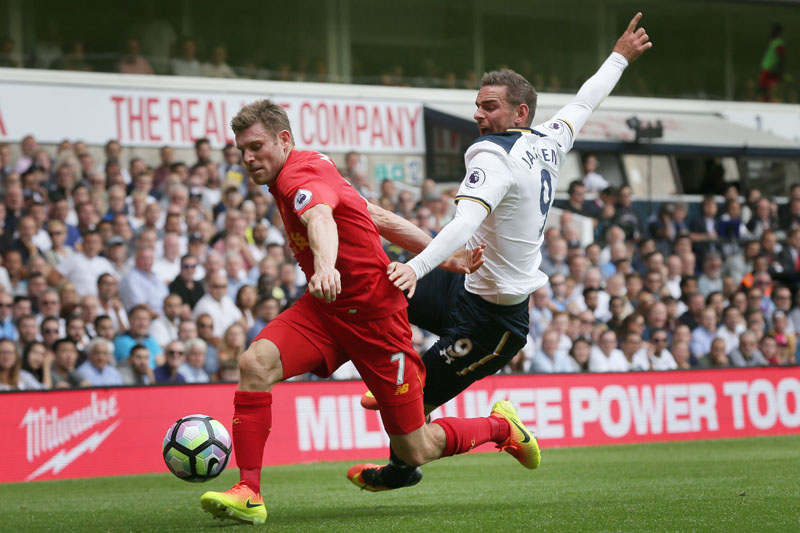 Liverpool's James Milner (left) beats Tottenham's Vincent Janssen to the ball during the English Premier League football match between Tottenham Hotspur and Liverpool at White Hart Lane in London, on Saturday, August 27, 2016. Photo: AP