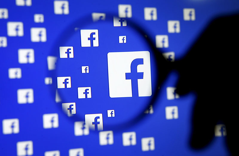 File - A man poses with a magnifier in front of a Facebook logo on display in this illustration taken in Sarajevo, Bosnia and Herzegovina, on December 16, 2015. Photo: Reuters