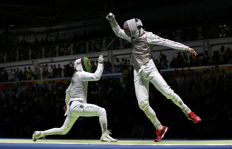 Victor Sintes of Albania competes with Richard Kruse of United Kingdom during 2016 Rio Olympics of Fencing Preliminary Menu0092s Foil individual Table of 32 at Carioca Arena 3 in Rio de Janeiro, on Sunday, August 7, 2016. Photo: Reuters