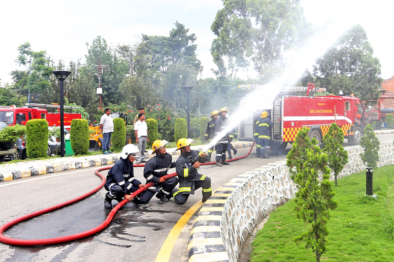 Fire fighters conducting a trial on the fire engine gifted by the Government of India, in Kathmandu, on Wednesday, August 24, 2016. Photo: RSS