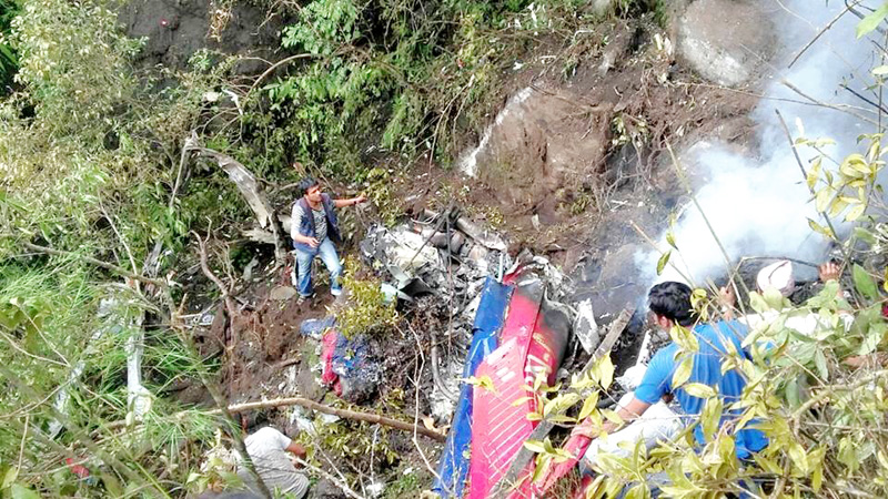 The wreckage of a Fishtail Air Helicopter that crashed at Madanpur in Nuwakot district, on Monday, August 8, 2016. Photo: RSS