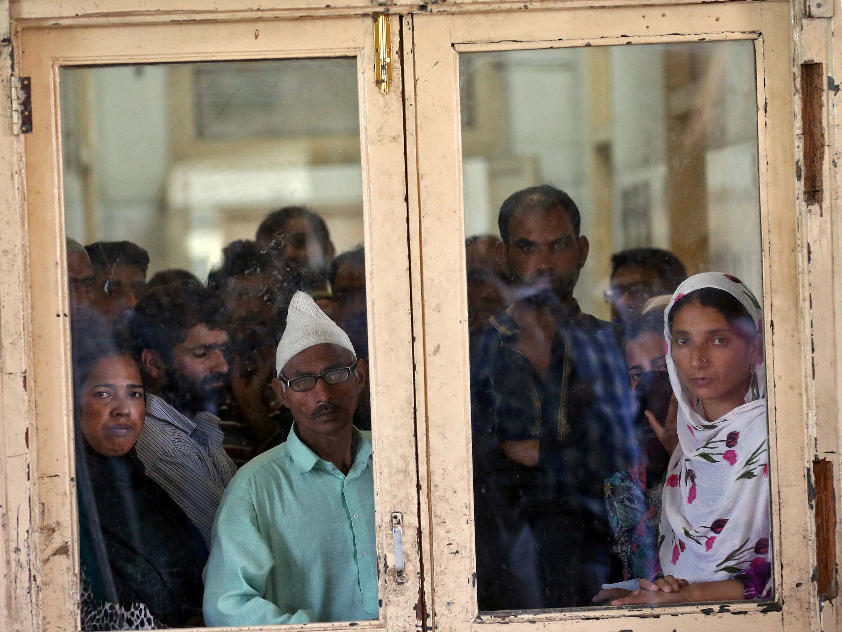 People wait for news at a hospital in Srinagar about family members whom they say were beaten by security forces near Srinagar following weeks of violence in Kashmir, on Thursday, August 18, 2016. Photo: Reuters