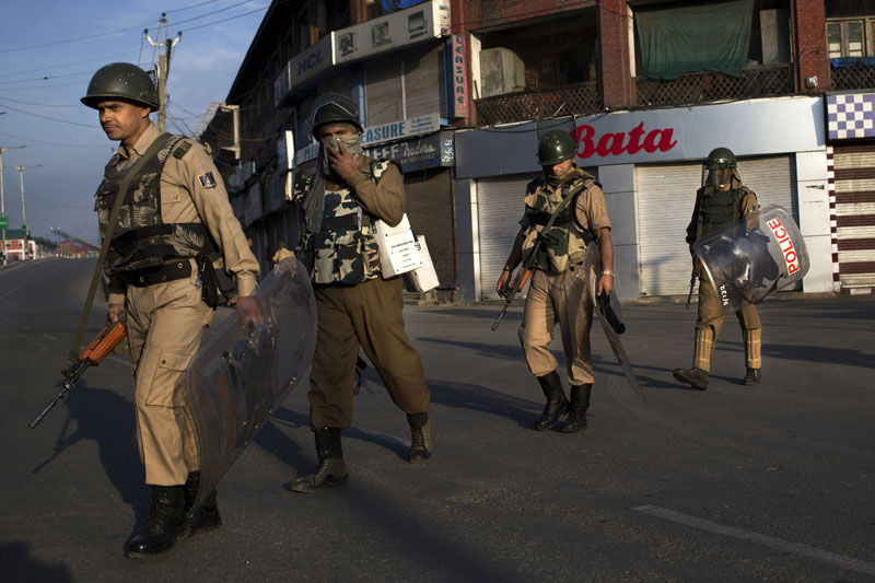 Indian paramilitary soldiers patrol during curfew in Srinagar, Indian-controlled Kashmir, on Friday, August 19, 2016. Photo: AP