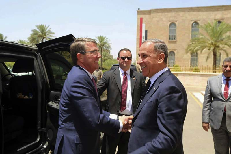 File- Visiting US Defense Secretary Ash Carter (L) shakes hands with Iraqi Defense Minister Khaled al-Obeidi at the Ministry of Defense, Baghdad, Iraq, on July 11, 2016. Photo: AP