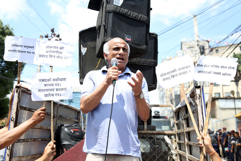 Dr Govinda KC addresses a mass gathered to demand that the government implement an agreement signed with him, outside the PM's residence in Baluwatar on Saturday, August 20, 2016. Photo: RSS