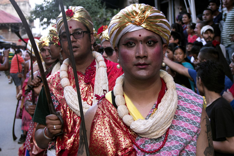 Artists get ready in a traditional attire to observe the Khadga Jatra at Jaya Bageshwori of Kathmandu, on Sunday, August 21, 2016. Every year on this day, the ancient sword is displayed to the public. As part of the festival, a sword is worshipped and covered with bamboo as per the rituals and placed on a wooden palanquin which is then taken around the town in a procession. Photo: RSS