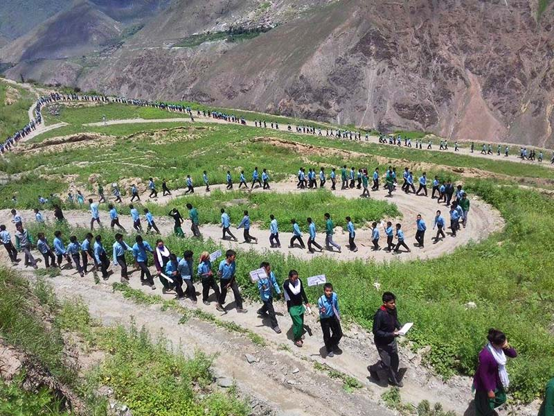 Students of Adarsha Higher Secondary School march with a purpose of generating awareness, during a religious and educational festival, in Juphal of Dolpa district, on Monday, August 15, 2016. Photo: RSS