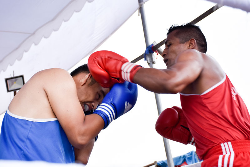 Manohar Basnet (right) of Jawalakhel Boxing Club and Gokul Gurung of Nepal APF Club fight during their 81kg weight category final bout of the fourth Nationwide and first Novice Boxing Tournament in Lalitpur on Sunday, August 28, 2016. Photo: Naresh Shrestha/THT