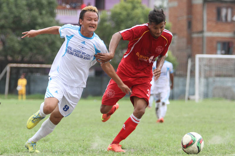 Players of Nayabasti Youth Club and Shree Kumari Club (right) vie for the ball during their Martyrs Memorial B nDivision League match at the Nepal APF Club grounds in Halchwok on Monday. The match ended at 1-1 draw. Photo: THT