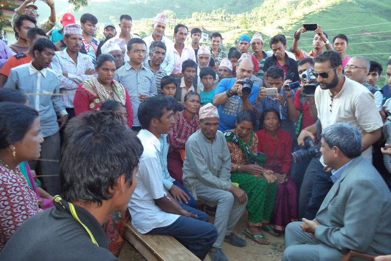 Minister for Physical Infrastructure and Transport Ramesh Lekhak (right, in the chair) interacts with family members of victims of a road accident, in Birta Deurali village of Kavrepalanchok district, on Sunday, August 28, 2016. The Minister had reached the remote village today to condole the death of 27 villagers in the accident around two weeks ago.