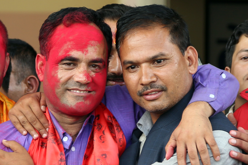 Newly appointed Nepal Students Union President Nainsingh Mahar (left) hugs his closest poll rival Manoj Mani Acharya after announcement of his election to the top position, in Kathmandu, on Thursday, August 18, 2016. Photo: RSS