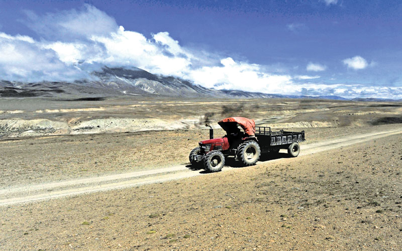 A tractor driven along a dirt track in Korala, Nepal-China border in Upper Mustang, on June 17, 2016.nA biannual trade fair in Tibet offers a rare opportunity for those living in the remote former Buddhist kingdom of Upper Mustang in Nepal to cross the usually closed border into China, which is cultivating closer ties with the Himalayan nation. Photo: AFP