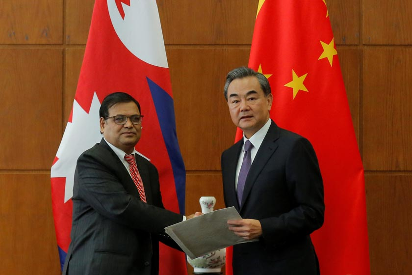 Nepal Premier's special envoy Krishna Bahadur Mahara (L) delivers documents to Chinese Foreign Minister Wang Yi during their meeting at the Ministry of Foreign Affairs in Beijing, China, 16 August 2016. REUTERS/Wu Hong/Pool