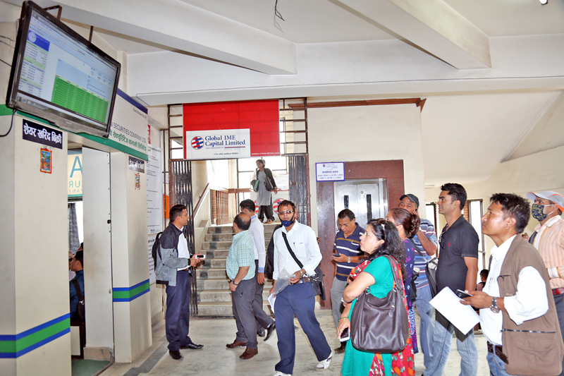 Pople throng at Nepal Stock Exchange office in Jamal to monitor share transactions after the share market slightly increased by 5% since yesterday, in Kathmandu, on Wednesday, August 10, 2016. Photo: RSS
