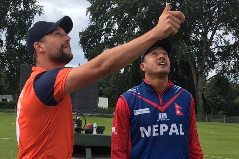 Captains of the Netherlands, Pieter Seelaar (left), and Nepal cricket team, Paras Khadka, ready for the toss during their first match of the ICC World Cricket League Championshipu0092s fourth round at the VRA Ground in Amstelveen on Saturday, August 13, 2016. Photo:  Netherlands CricketVerified account
