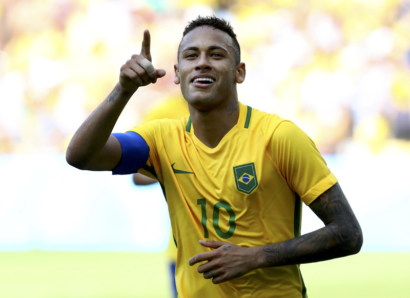 Neymar of Brazil celebrates after scoring a penalty goal against Honduras. Photo: Reuters