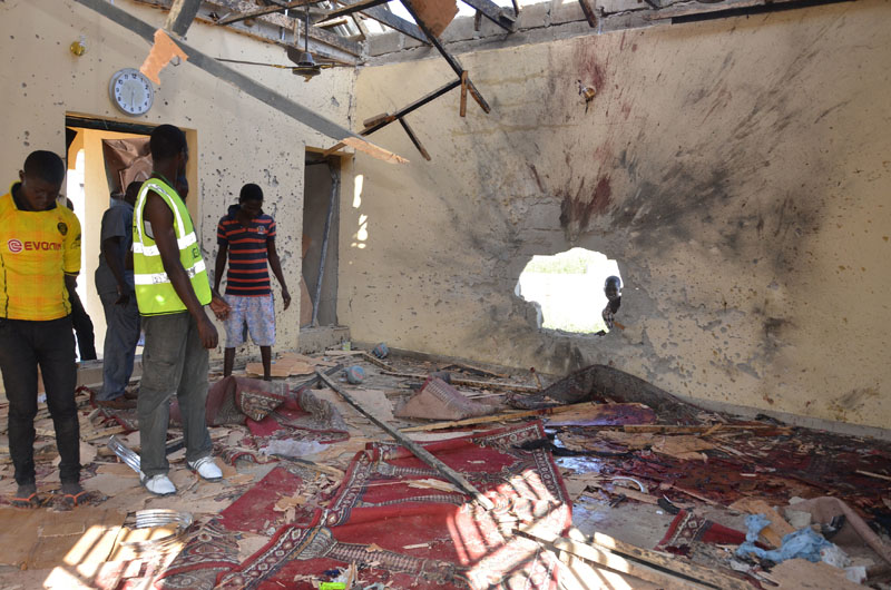 FILE - People inspect a damaged mosque following an explosion in Maiduguri, Nigeria, on Friday, October 23, 2015. Photo: AP
