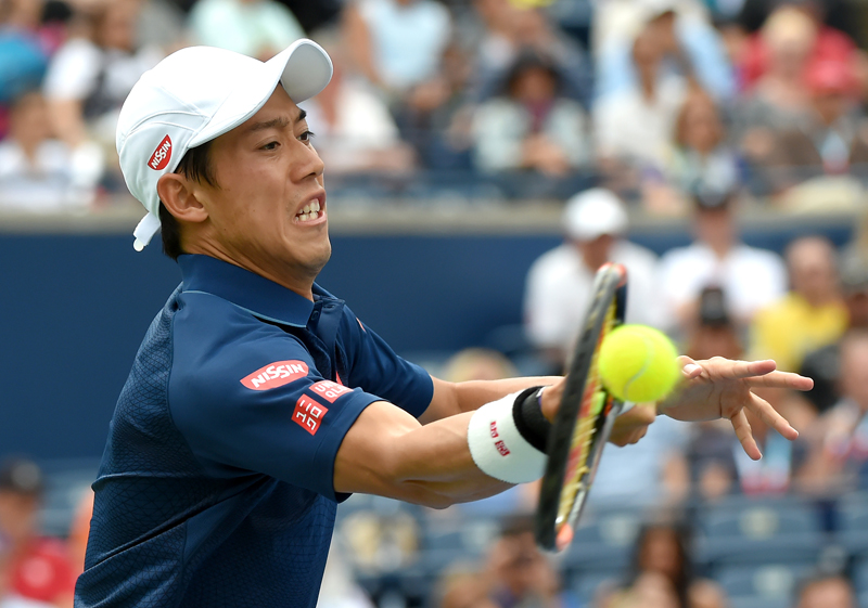 Kei Nishikori of Japan plays a shot against Novak Djokovic of Serbia in the mens final on day seven of the Rogers Cup tennis tournament at Aviva Centre in Toronto, July 31, 2016. Mandatory Credit: Dan Hamilton-USA TODAY Sports